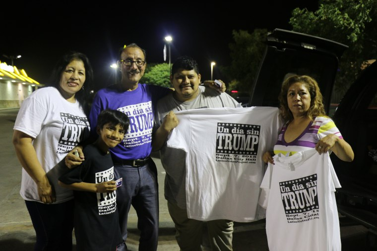 Carlos Quintanilla, 57, in purple, gathers with a group of volunteers who helped him plan an Anti-Trump rally in Dallas, Sunday, Sept. 6, 2015. Quintanilla said he was able to do it with the help of a small committee of seven, and nearly 60 volunteers who helped him spread the word on the streets and through social media.
