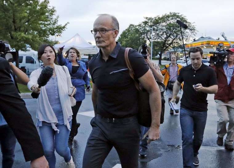 Image: Walter Palmer arrives at the River Bluff Dental clinic in Bloomington