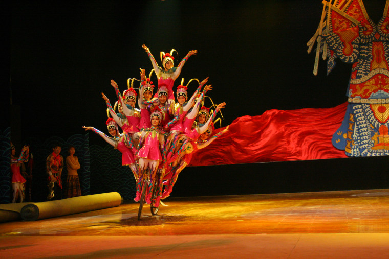 The acrobats often practice and hour or two each day and then perform one or two shows per day, seven days a week.
