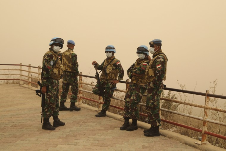 Image: U.N peacekeepers of the United Nations Interim Force in Lebanon (UNIFIL) wear face masks while they monitor the Lebanese-Israeli border during a sandstorm in Kfar Kila village, in south Lebanon