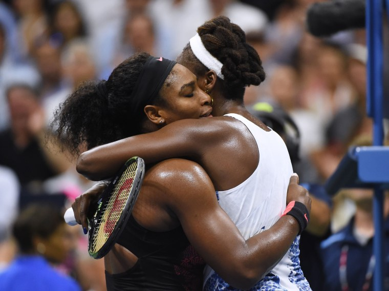 Image: Serena Williams hugs her sister Venus Williams
