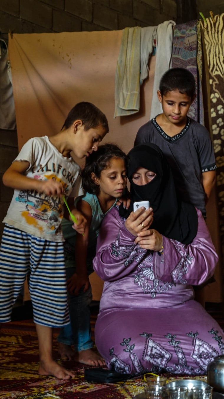 Image: Syrian refugee Sahar and three of her children