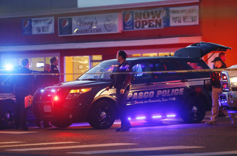 Pasco Police officers investigate the scene on Feb. 10, 2015 of the shooting of Antonio Zambrano-Montes, who was shot by police in Pasco, Wash.
