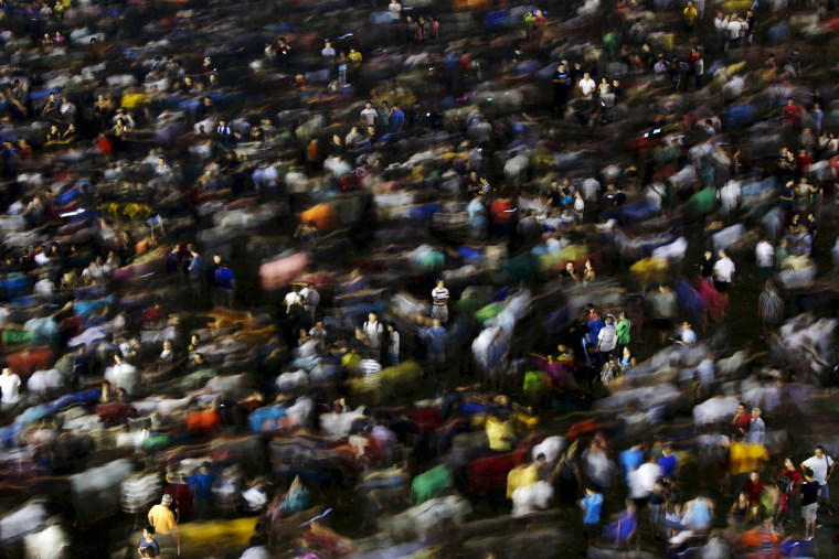Image: The crowd disperses after attending an election campaign rally by the opposition Workers' Party in Singapore
