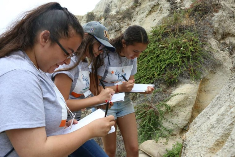 High school students with the GEAR UP program at California State University, Fullerton, participated in a two-week summer program focused on California geology. As part of the program, students traveled to San Clemente State Beach and Dana Point in southern California to make observations and take measurements of the rocks and the ocean.