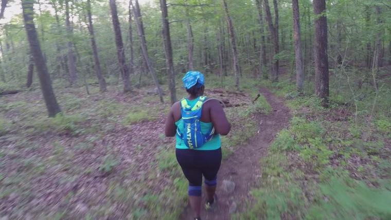 Mirna Valerio runs through a forest.