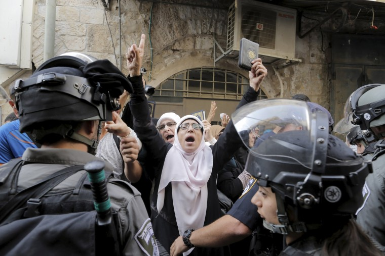 Image: Israeli policemen prevent Palestinian women from entering the compound which houses al-Aqsa mosque, known by Muslims as the Noble Sanctuary and by Jews as the Temple Mount, in Jerusalem's Old City