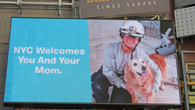 Billboard in Times Square honoring Bretagne the dog and her handler, Denise Corliss