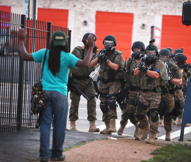 Image: Police confront a protester