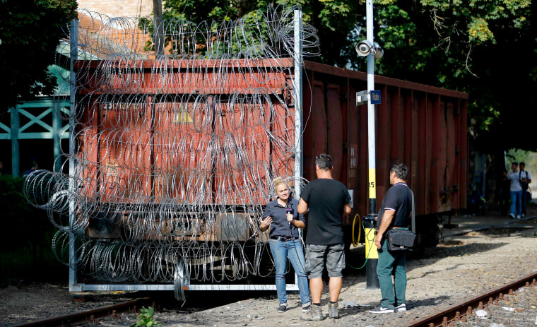 Image: Razor-wire-covered train car in Roszke, Hungary