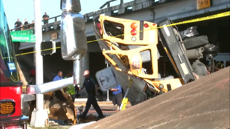The school bus overturned on a highway in Houston on Tuesday morning, school officials said.