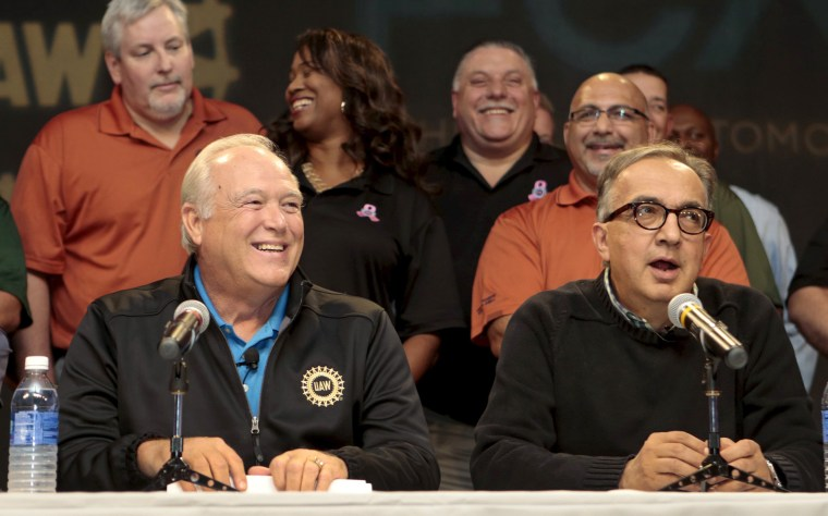 Image: United Auto Workers (UAW) President Dennis Williams and FCA CEO Sergio Marchionne hold a news conference to announce a tentative agreement between the UAW and FCA US LLC in Detroit,