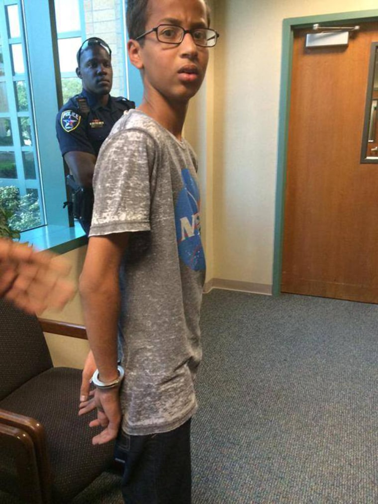 "Ahmed Mohamed, A 14-year-old North Texas student, appears in handcuffs, after his arrest on charges of making a ""hoax bomb."""