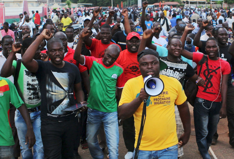Image: Protesters chant slogans against the presidential guard in Ouagadougou