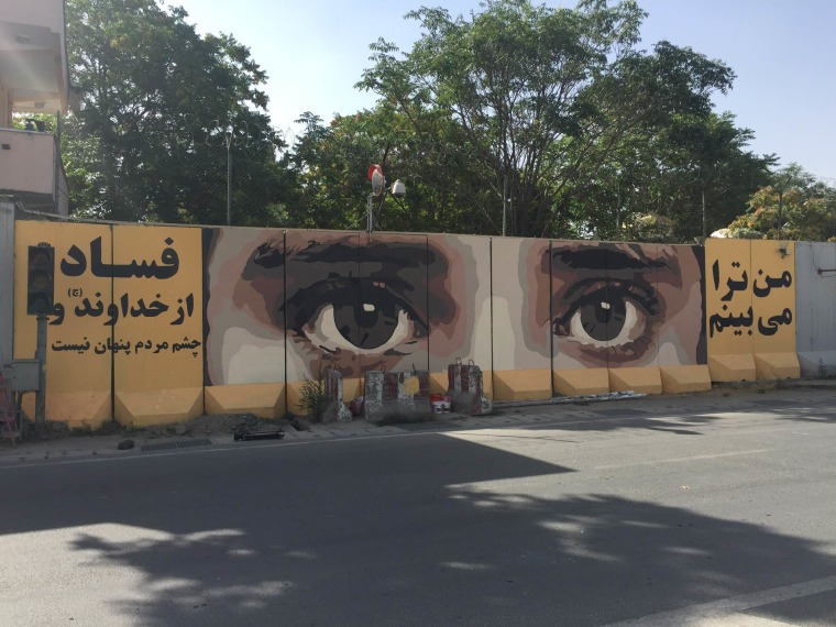 "Image: An Afghan artist's warning to corrupt politicians: ""I see you"""