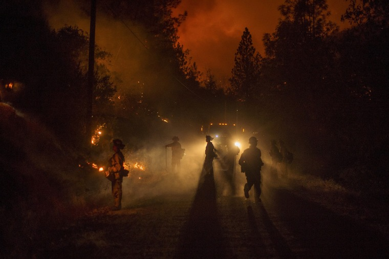Image: Firefighters light a backfire while battling the Butte fire near San Andreas