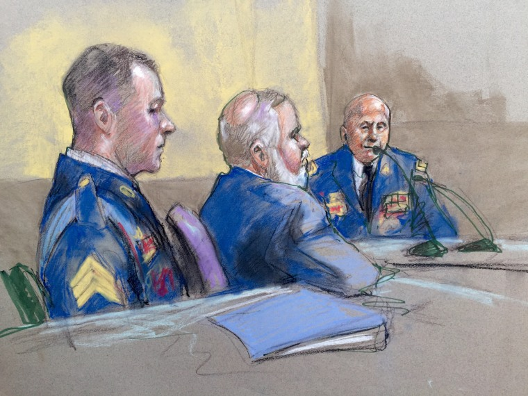 Army Sgt. Bowe Bergdahl, left, and defense lead counsel Eugene Fidell, center, look on as Maj. Gen. Kenneth Dahl is questioned during a preliminary hearing to determine if Sgt. Bergdahl will be court-martialed, Friday, Sept. 18, at Fort Sam Houston, Texas.