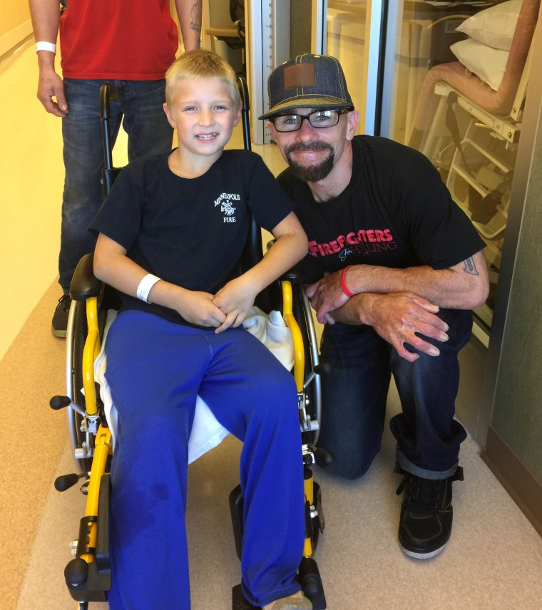 Jake LaFerriere visits a young burn victim in the hospital. LaFerriere sustained third- and fourth-degree burns when he tended to a house explosion in 2010.
