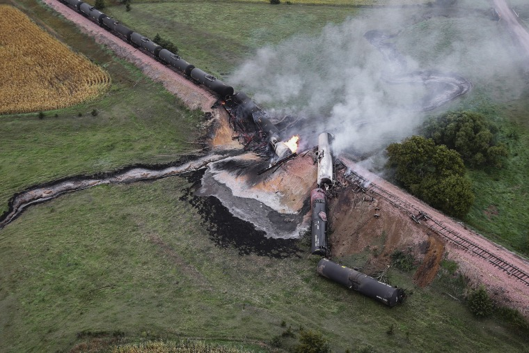 Smoke rises from a burning ethanol tanker car, Saturday after the 98-car train derailed in a rural part of Bon Homme County between the towns of Scotland and Lesterville, S.D.