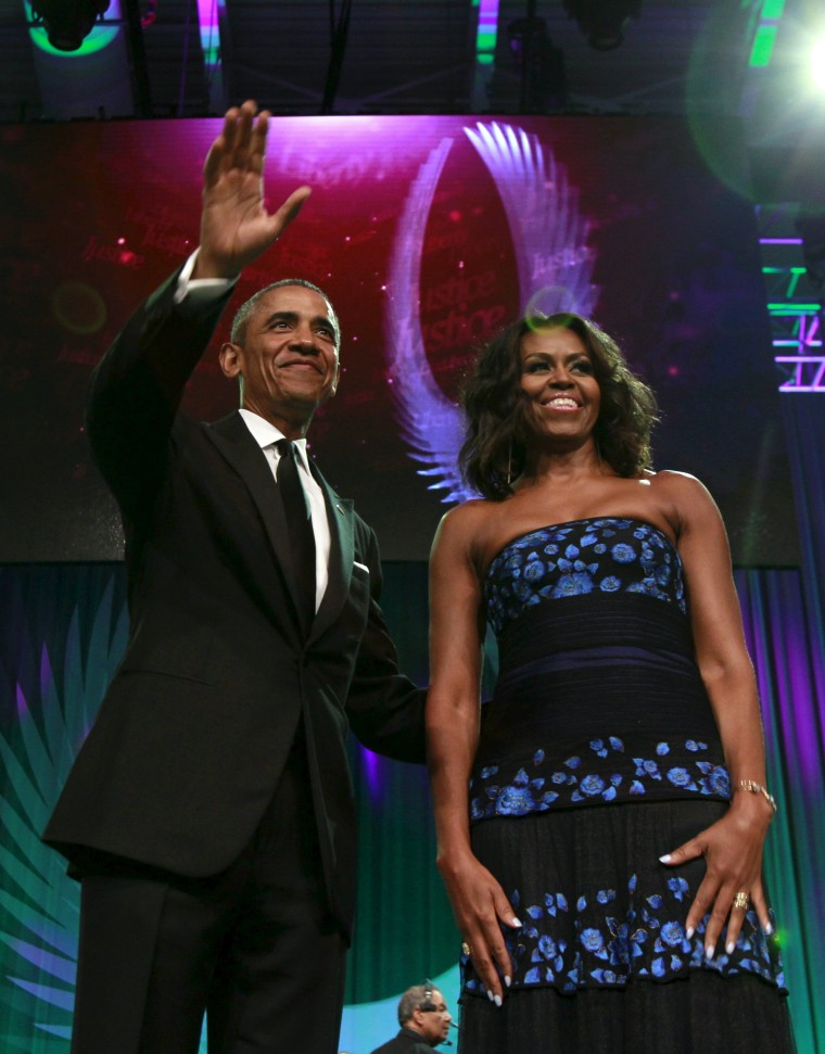 Image: President Barack Obama and First Lady Michelle Obama arrive at the Congressional Black Caucus Foundation's 45th Annual Legislative Conference Phoenix Awards Dinner