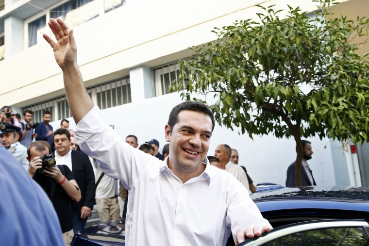 Image: Former Greek prime minister Alexis Tsipras waves as he leaves a polling station in Athens
