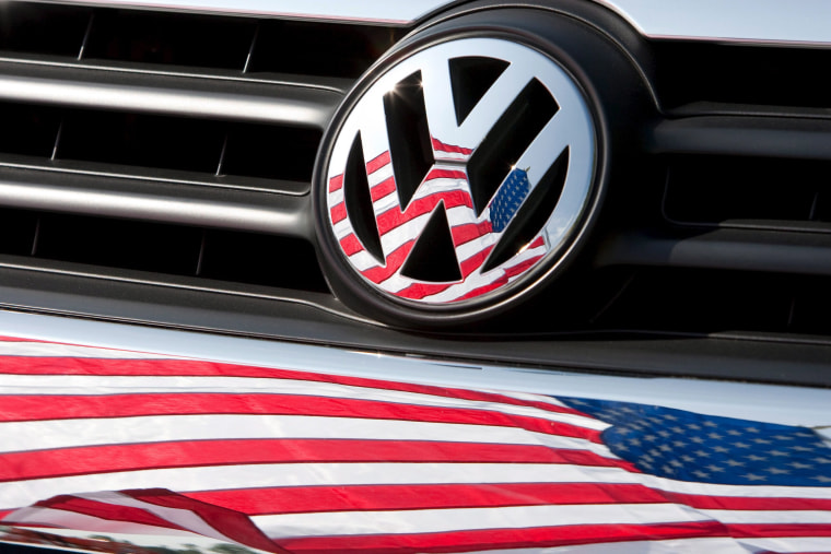 Image: VW logo with American flag reflection