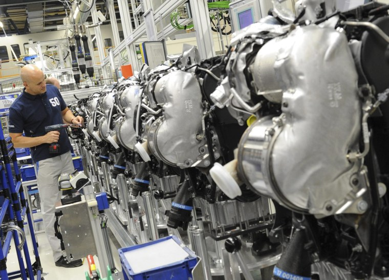 Image: VVolkswagen employee works on a diesel engine