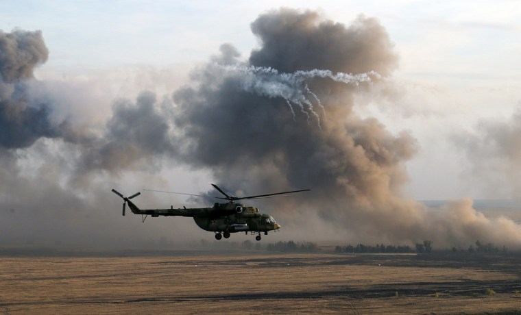 Image: A MI-8 Helicopter flies during Russias large-scale Center-2015 military exercises