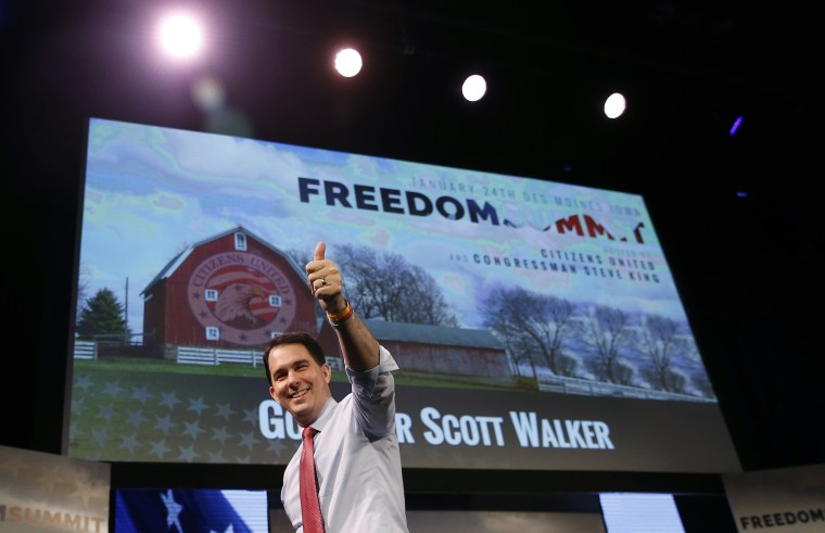 Image: Wisconsin Governor Walker walks off the stage after speaking at the Freedom Summit in Des Moines