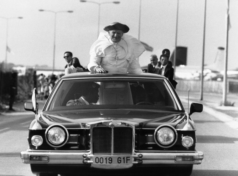 Image: Pope John Paul II stands up in his Rolls Royce in 1982