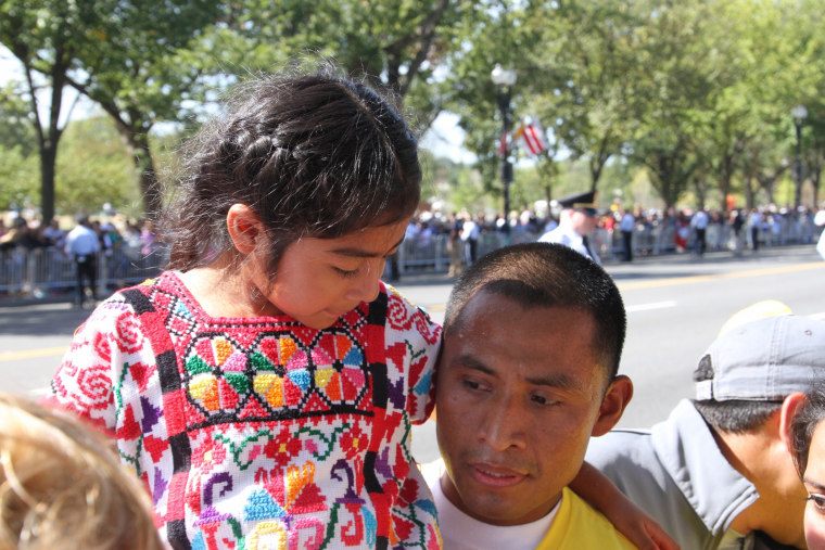 Raul Cruz holds his daughter Sophie.