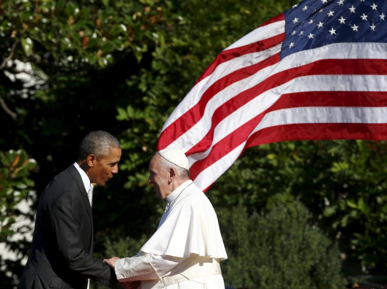 Image: U.S. President Barack Obama shakes hands with Pope Francis during a welcoming ceremony at the White House in Washington