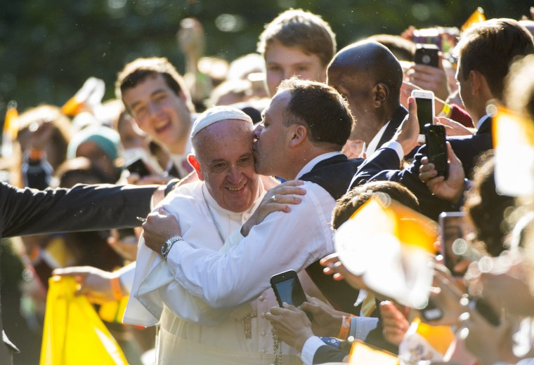 Image: Pope Francis receives a kiss, outside the Apostolic Nunciature to the United States on September 23, 2015 in Washington, DC.