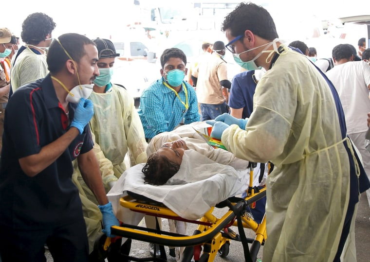 Image: Medical personnel tend to a wounded pilgrim following a crush caused by large numbers of people pushing at Mina, outside the Muslim holy city of Mecca