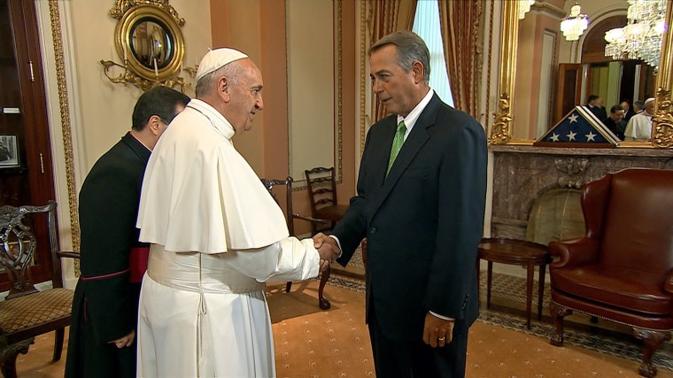 Pope Francis shakes hands with House Speaker John Boehner on Capitol Hill.