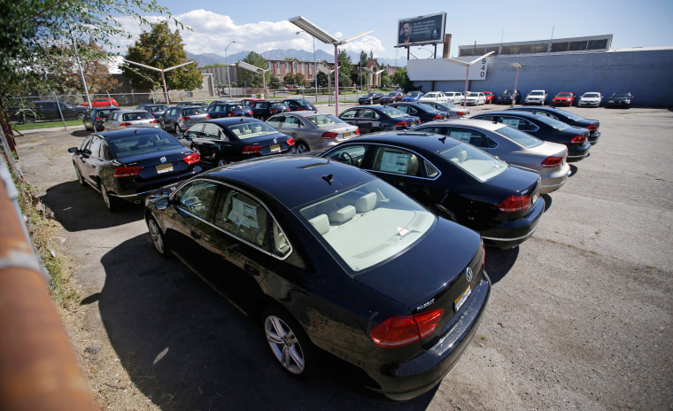 Image: Volkswagen diesels are shown on a storage lot near a VW dealership