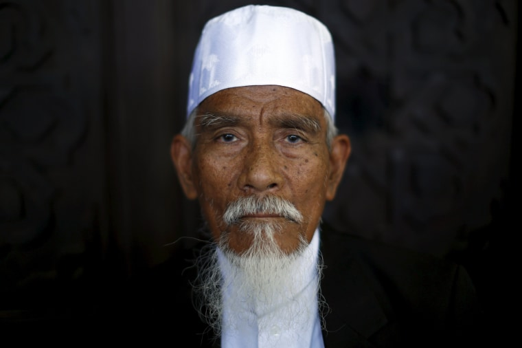 Image: An elderly Muslim man poses for a portrait at a mosque during the festival of Eid-al-Adha in Bangkok