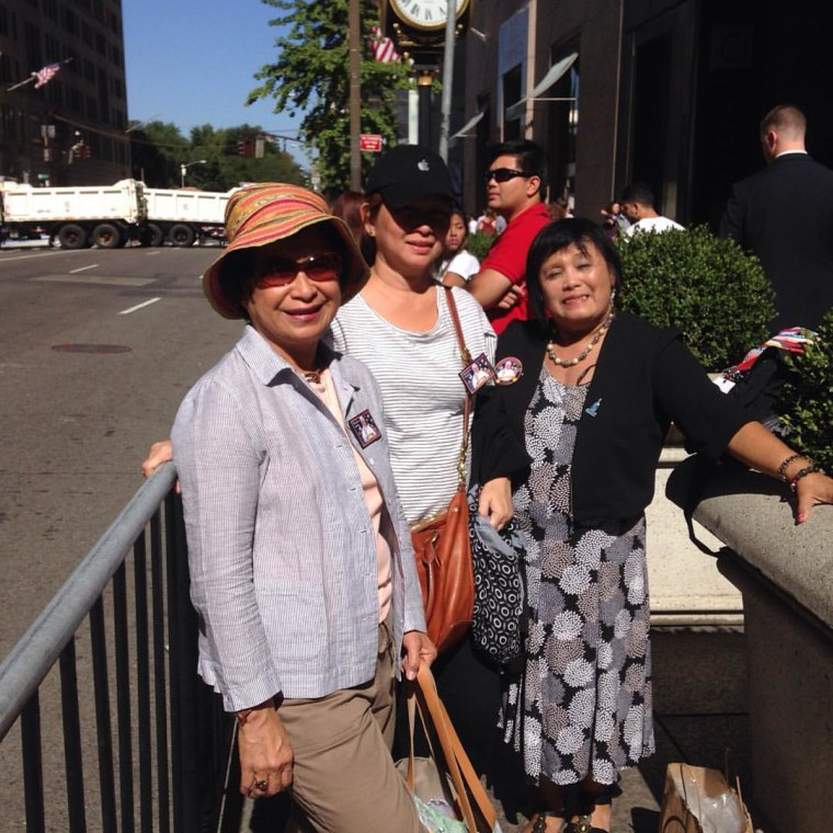 Chona Suico, Gigi Suico, and Lolita Ocampo arrived at Fifth Ave near 57th St. at 1 p.m. ET Thursday in hopes of catching a glimpse of Pope Francis when he arrived in New York later that evening.