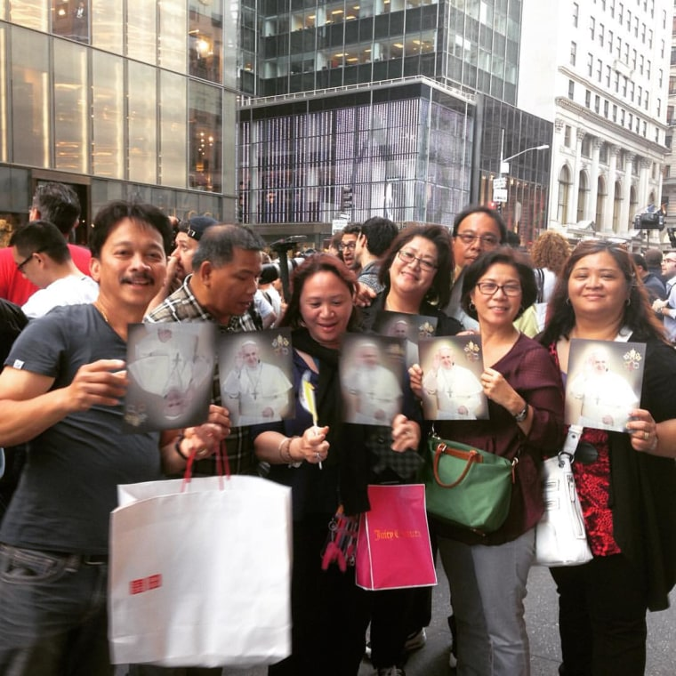 Filipino-American Catholics from churches on Long Island pose on Fifth Avenue with photos of Pope Francis on Thursday, September 24, 2015.
