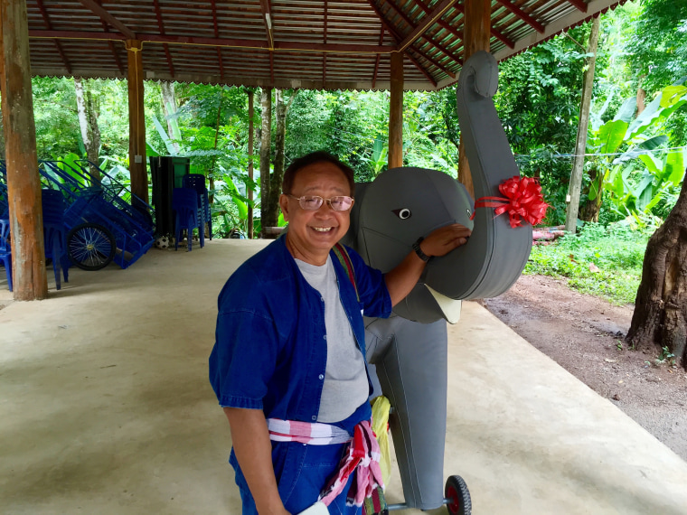 Prasop Tipprasert, the founder of the program, with a model elephant he uses to first teach kids how to ride.
