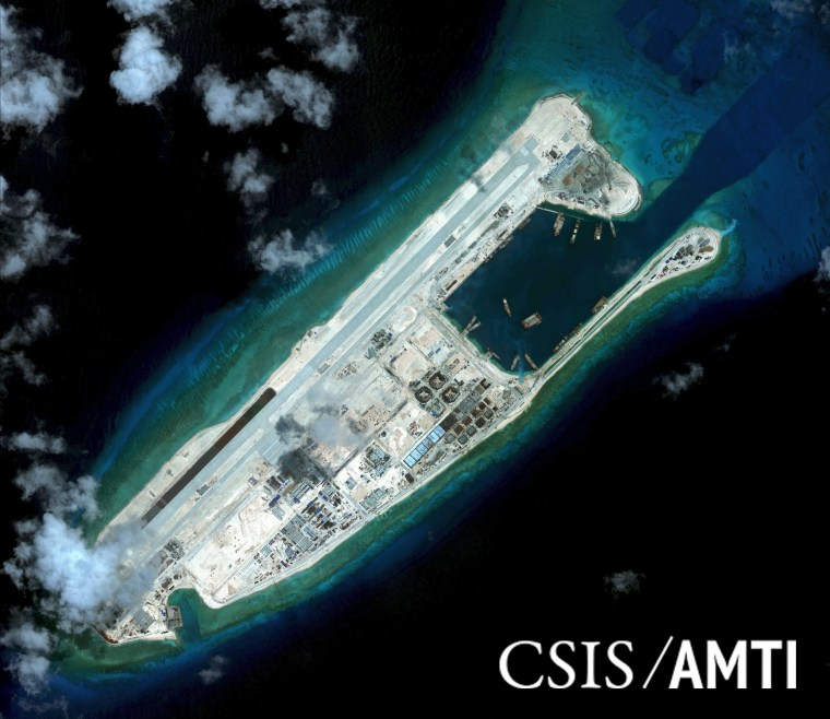 Image: Handout photo of Fiery Cross Reef is shown in this satellite image in the South China Sea