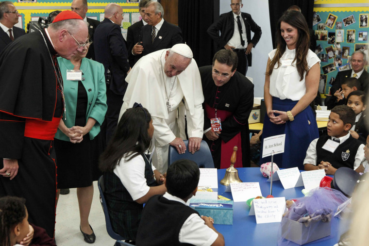 Image: Pope Francis speaks with children while visits a classroom in Our Lady Queen of Angels School in East Harlem, in New York