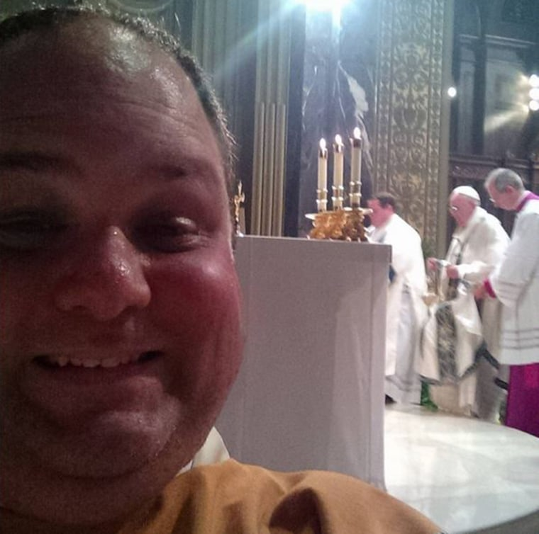 Rev Stephen Paolino posted this photo of himself during Pope Francis' Mass at the Cathedral Basilica of Saints Peter and Paul.