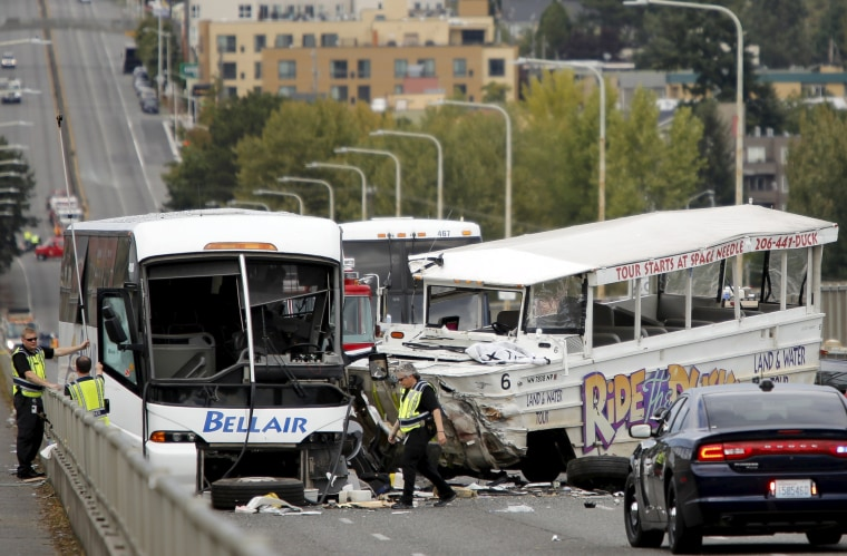 Image: Investigators are pictured at the scene of a crash between a Ride the Ducks vehicle and a charter bus on the Aurora Bridge in Seattle, Washington