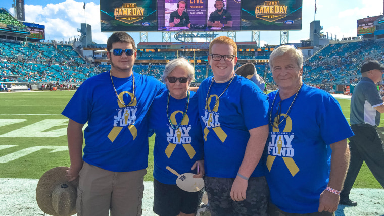 Caleb Farrell (third from left) with his brother and parents