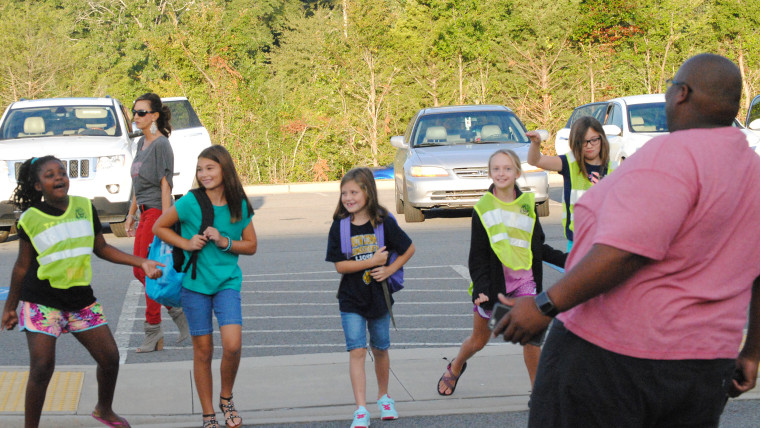 Principal welcomes students back with dancing