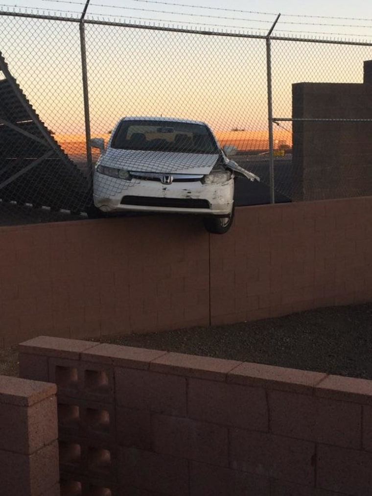 The car smashed into an airport perimeter fence.