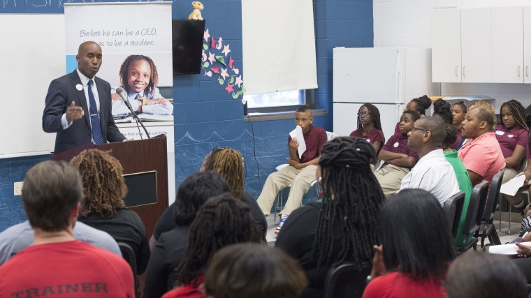 "Edward ""Smitty"" Smith, Director, Justice Grants Administration and Show Up, Stand Out, addresses attendees at the launch of the new SUSO middle school program at Kelly Miller Middle School in D.C. Sept. 17, 2015. Photo by: John Harrington."