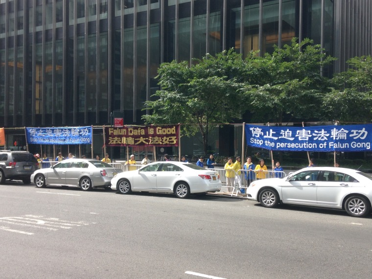 Facing the Waldorf Astoria on Park Avenue in Manhattan, members of Falun Gong, a spiritual movement banned in China, hold up signs calling for the end of the group's persecution. Chinese President Xi Jinping and wife Peng Liyuan stayed at the famed hotel during their trip to New York.