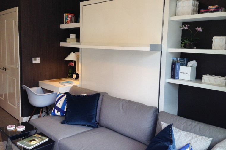 Studio model unit has Murphy-style bed wall unit to maximize 372 square feet.